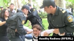 Police detain a protester during the unsanctioned demonstration on May 21.
