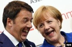 Ангела Меркель и Маттео Ренци в начале саммита АСЕМ. 16 октября