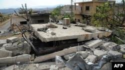 تصویری که به گزارش خبرگزاری دولتی سوریه مربوط به تخریبها بر اثر حمله روز یکشنبه اسرائیل به دمشق است.