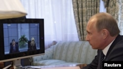 Vladimir Putin na video konferenciji povodom terorističkog napada u Moskvi, 29. mart 2010. - ilustrativna fotografija