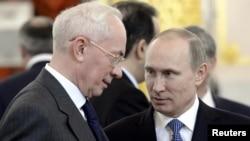 Ռուսաստանի նախագահ Վլադիմիր Պուտին և Ուկրաինայի վարչապետ Նիկոլայ Ազարով, Մոսկվա, 24-ը դեկտեմբերի, 2013թ․