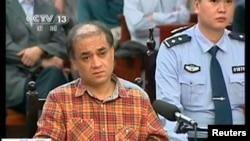 Уйгурский ученый Ильхам Тохти на скамье подсудимых по обвинению в сепаратизме