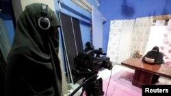 Египет телестанциясындагы аялдар студиясындагы бир көрүнүш. Каир.