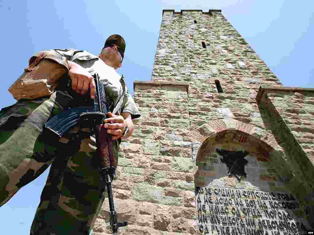 A peacekeeper from the NATO-led force stands guard in front of a monument commemorating the Battle of Kosovo Polje in Gazimestan in 2007.