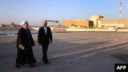 Iranian President Hassan Rohani (left) walks with Iran's Atomic Energy chief Ali Akbar Salehi at the Bushehr nuclear power plant. (file photo)