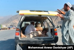 A victim of the blast is carried away in a car in Nangarhar Province on September 11.