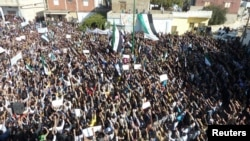 Syrian antiregime protesters gather in Hula, near the city of Homs