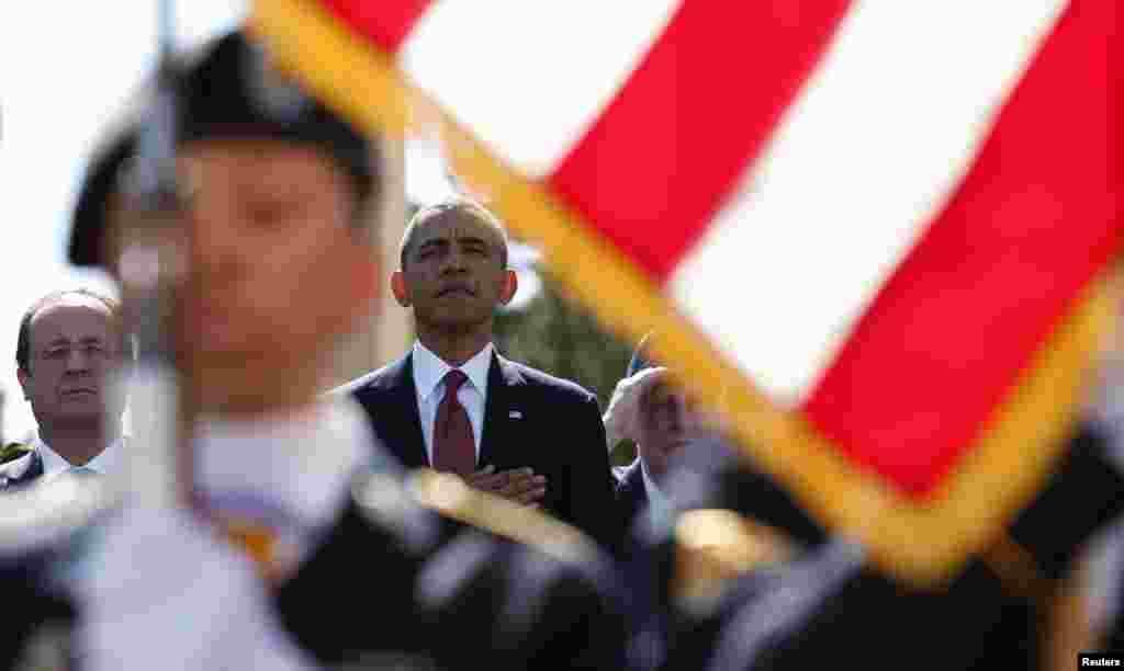 U.S. President Barack Obama and French President Francois Hollande participate in the 70th French-American Commemoration D-Day Ceremony at the Normandy American Cemetery in Colleville-sur-Mer.