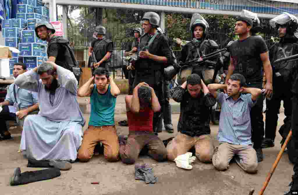 Security forces detain supporters of ousted President Muhammad Morsi, who have been staging sit-in protests to demand his reinstatement.