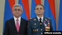 Armenia - President Serzh Sarkisian awards a medal to Yerevan's deputy police chief, Valery Osipian, 21Sep2015.