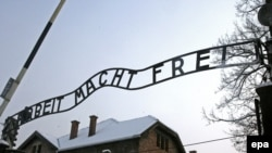 The replacement sign at the entrance to Auschwitz