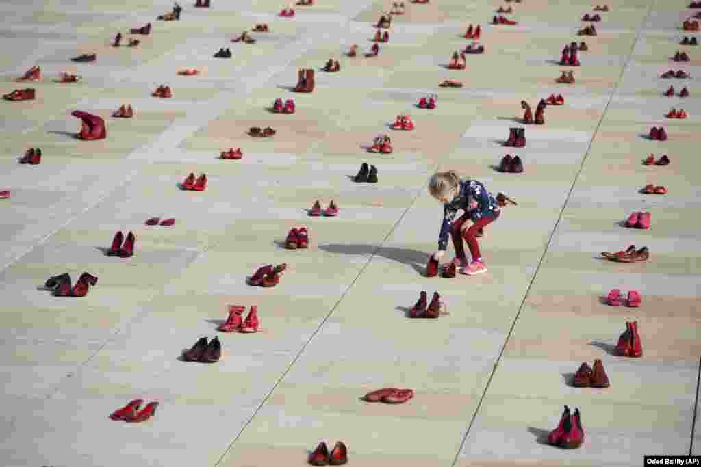 Hundreds of red shoes are displayed as a protest against violence toward women in Israel at Habima Square in Tel Aviv on December 4.(AP/Oded Balilty)