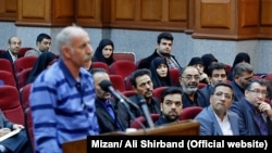 Iranian Gonabadi Dervish, Mohammad Salas who has been accused of killing police officers by bus, in his hearing session in a court in Tehran on Sunday March 11, 2018.