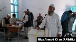 A Pakistan voter casts his ballot on October 14.
