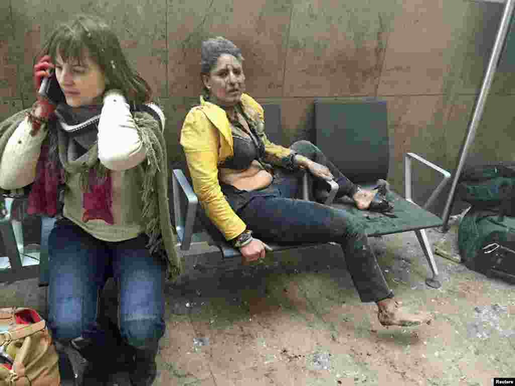 Injured people are seen at the scene of explosions at Brussels' Zaventem airport that were claimed by the Islamic State extremist group on March 22. (Reuters/Ketevan Kardava/Courtesy of 1tv.ge)