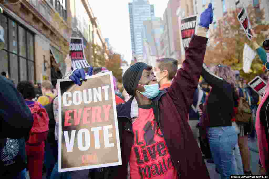 People rally to demand that every vote be counted outside of the Pennsylvania Convention Center in Philadelphia, Pennsylvania, USA, 05 November 2020.