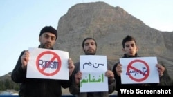 "Iranians protest against the banning of Afghans in Isfahan from a public park on April 1, also known as Nature Day. One of the signs reads, ""I Am Also An Afghan."""