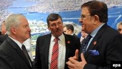 U.S. Defense Secretary Robert Gates (left), British Defense Secretary Bob Ainsworth (center), and Afghanistan's Defense Minister Abdul Rahim Wardak chat before the NATO meeting in Istanbul.