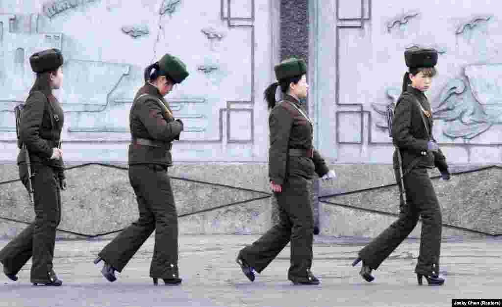 Female soldiers from North Korea patrol along the banks of the Yalu River, near the North Korean town of Sinuiju, opposite the Chinese border city of Dandong. (Reuters/Jacky Chen)
