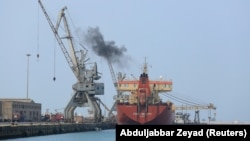 A ship unloads a cargo of fuel at the Red Sea port of Hudaydah.