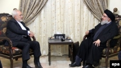 A handout picture made available by Hezbollah media office shows Hezbollah leader Hassan Nasrallah (R) meeting with the Iranian Foreign Minister, Mohammad Javad Zarif (L), in Beirut, Lebanon, 12 August 2015.