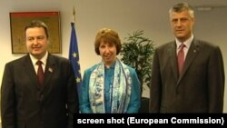 Serbian Prime Minister Ivica Dacic (left), EU foreign-policy chief Catherine Ashton (center), and Kosovo Prime Minister Hashim Thaci pose for a photo after a meeting in June.