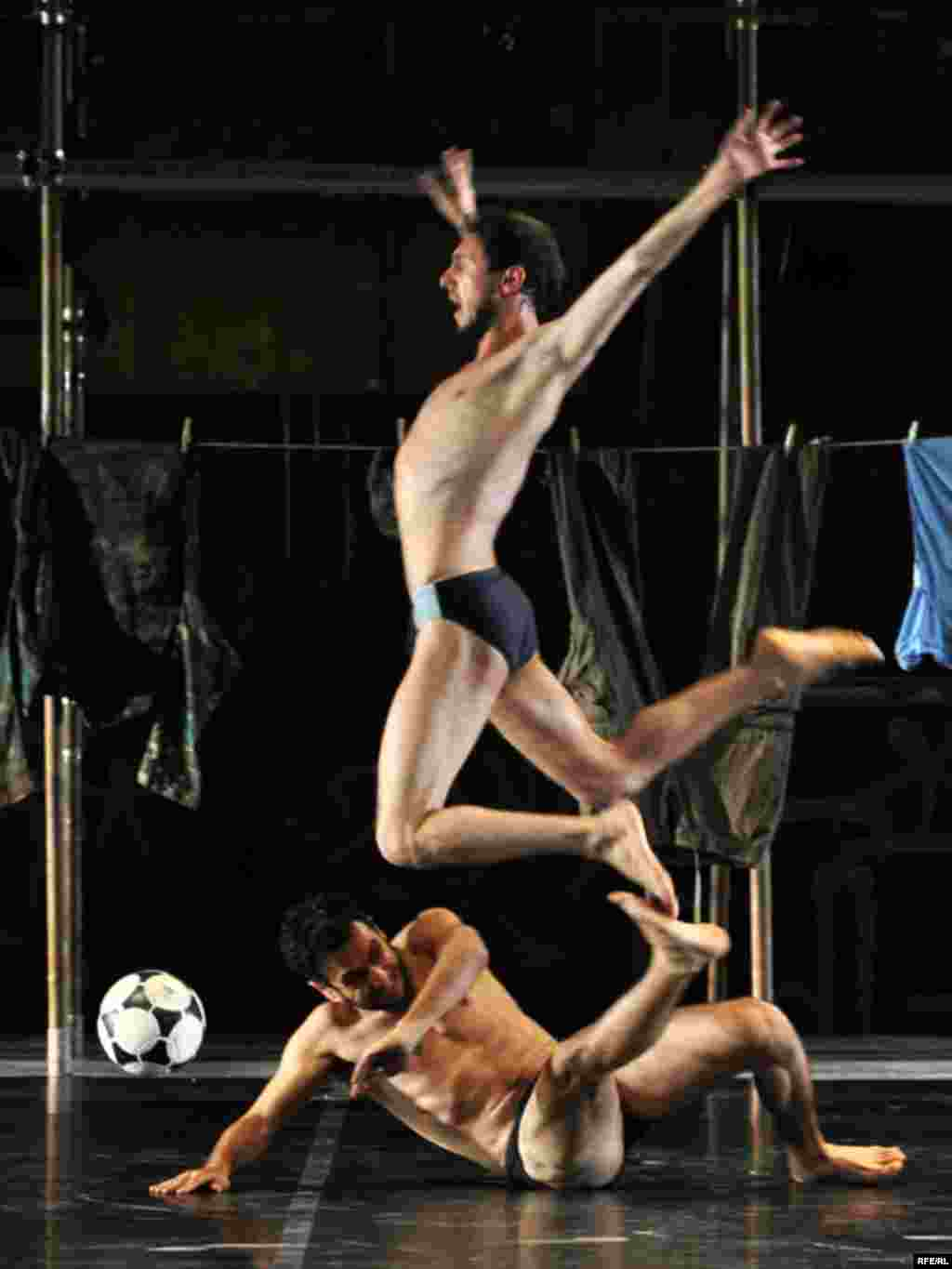 "...while in Sarajevo, dancers perform an avant-garde piece titled ""Football, Football."" Photo by Midhat Poturovic for RFE/RL"