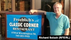 Greg Froehlich in front of his restaurant, one of a few left in downtown Steubenville