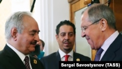 Khalifa Haftar (left), the chief of the Libyan National Army, meets with Russian Foreign Minister Sergei Lavrov in Moscow on August 14.