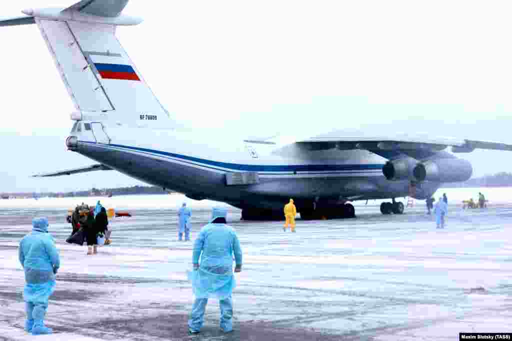 Medical personnel at an airport outside Tyumen, Russia, prepare for the arrival of Russian citizens from China.