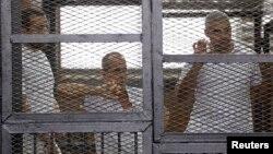 Багер Мухаммад, Пітер Ґресті та Мухаммад Фагмі (фото за червень 2014 року)