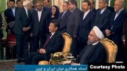 Chinese president Xi Jinping (foreground left) and Iranian President Hassan Rohani (foreground right) in Tehran on January 23.