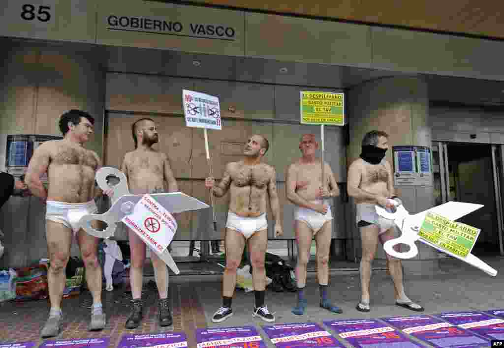 Protesters wearing diapers picket the Spanish government's social cuts, the construction of a high-speed train, and the military budget in front of the Basque government's headquarters in the northern city of Bilbao. (AFP/Rafa Rivas)