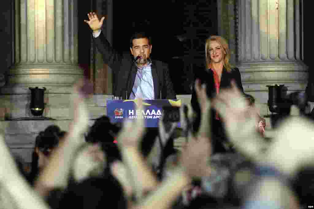 Greek parties on both the far left and far right made gains in the vote. Alexis Tsipras (left), the leader of the Coalition of the Radical Left (Syriza), and candidate Rena Dourou celebrate with supporters in Athens.