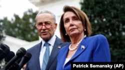 House Speaker Nancy Pelosi (right) and Senate Minority Leader Chuck Schumer and two others made the demand in a letter to the FBI released on July 20.