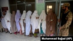 FILE: Pakistani women waiting to cast their votes in by-election held in Peshawar in 2017.