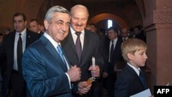 Armenia -- President Serzh Sarkisian (L), his Belarus counterpart Aleksandr Lukashenko and his son Nikolay attend the opening ceremony for a newly built Armenian church, 14May2013