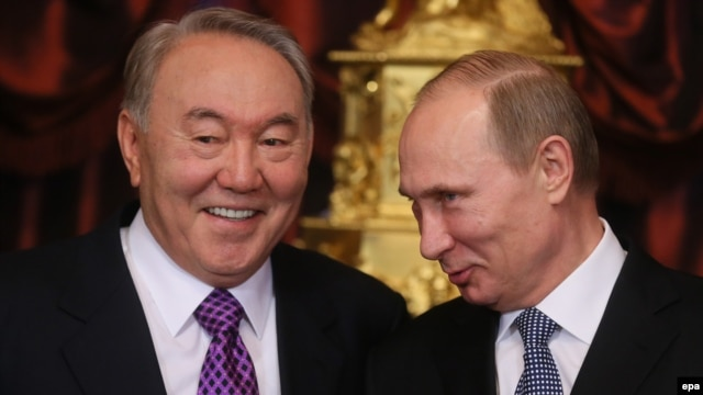 Russian President Vladimir Putin (right) with his Kazakh counterpart Nursultan Nazarbayev. Both Moscow and Astana have been singled out for criticism in a new report on civil liberties around the globe.