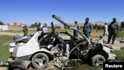 File photo of the wreckage of a vehicle at the site of a roadside bomb in eastern Afghanistan in April.