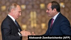 Russian President Vladimir Putin (left) prepares to shake hands with Egyptian counterpart Abdel Fattah al-Sisi after giving a press conference following their talks at the presidential palace in the capital Cairo, on December 11.