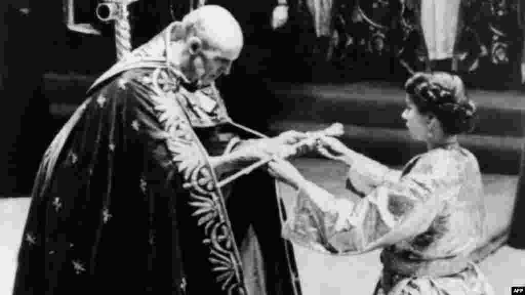 Elizabeth receives the Sword of State from the Archbishop of Canterbury prior to her coronation ceremony in Westminster Abbey on June 2, 1953.