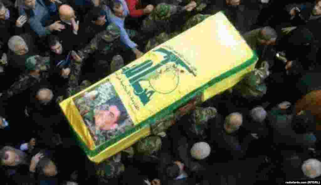 Members of Lebanon's militant Shi'ite Muslim movement Hizbollah carry Kantar's coffin. Eight other people were reported killed in the strike near Damascus on December 20.