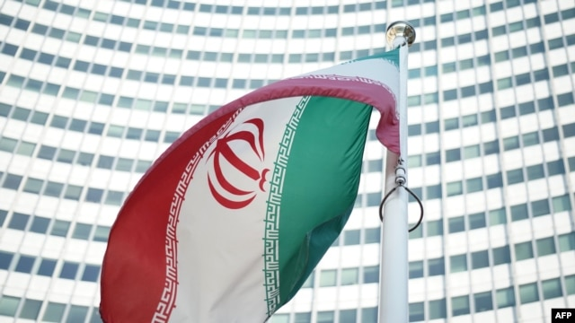 An Iranian flag flies outside the Vienna International Center where the so-called EU 5+1 talks with Iran are taking place inside.