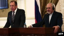 Russian Foreign Minister Sergei Lavrov (left) and his Iranian counterpart, Mohammad Javad Zarif, give a joint press conference in Tehran on December 11.