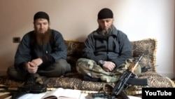 Abu Umar al-Shishani (left) is thought to be among IS militants besieging the Syrian town of Kobani. (file photo)