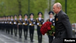 Russian President Vladimir Putin takes part in a flower-laying ceremony at the Tomb of the Unknown Soldier on Victory Day in Moscow.