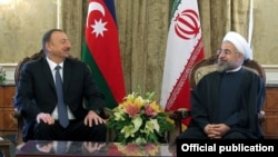 Iran's President Hassan Rohani (right) officially welcomes his Azeri counterpart, Ilham Aliyev, in Tehran on April 9.