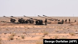 Syrian Army artillery are stationed near the village of Huraybishah, within the administrative borders of Syria's eastern Deir al-Zour Province on September 3.