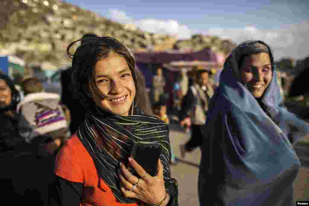 An Afghan girl smiles as she walks away after visiting the Sakhi shrine in Kabul. (Reuters/Zohra Bensemra)