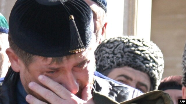 Chechen President Ramzan Kadyrov cries during the opening ceremony of a mosque in the village of Kurchaloi, outside Grozny, in October 2009.